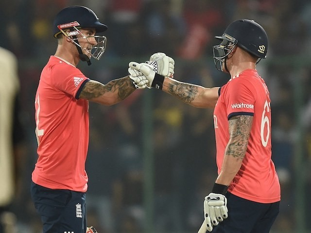 Jason Roy and Alex Hales bump fists during the World Twenty20 semi-final between England and New Zealand on March 30, 2016