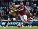 Andy Carroll and Laurent Koscielny in action during the Premier League game between West Ham United and Arsenal on April 9, 2016