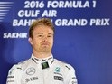 Mercedes driver Nico Rosberg celebrates on the podium after winning the Bahrain Formula One Grand Prix at the Sakhir circuit in Manama on April 3, 2016