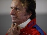 Former F1 driver Emerson Fittipaldi before taking part in a parade to mark the race's 50th anniversary ahead of this year's British Formula One Grand Prix at Silverstone Circuit on July 4, 2014