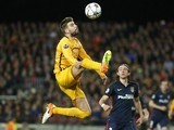 Gerard Pique in a thought-provoking position during the Champions League quarter-final between Barcelona and Atletico Madrid on April 5, 2016