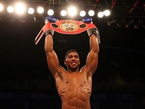 Anthony Joshua celebrates winning the IBF world heavyweight belt on April 9, 2016