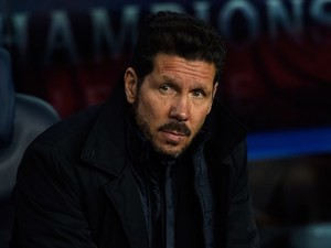 Diego Simeone watches on during the Champions League quarter-final between Barcelona and Atletico Madrid on April 5, 2016