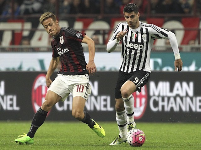Alvaro Morata and Keisuke Honda in action during the Serie A game between Milan and Juventus on April 9, 2016