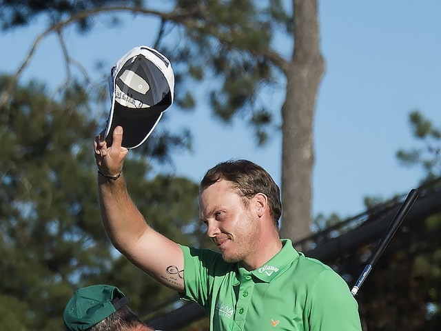 Danny Willett celebrates on the 18th hole during the final round of The Masters on April 10, 2016