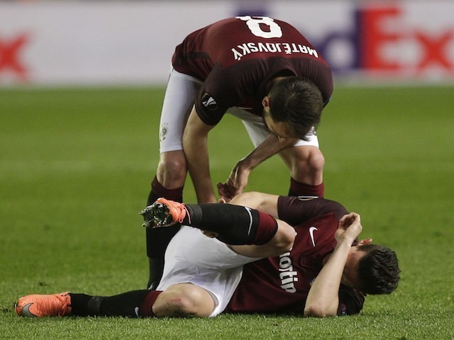 Mario Holek lies injured during the Europa League quarter-final between Villarreal and Sparta Prague on April 7, 2016
