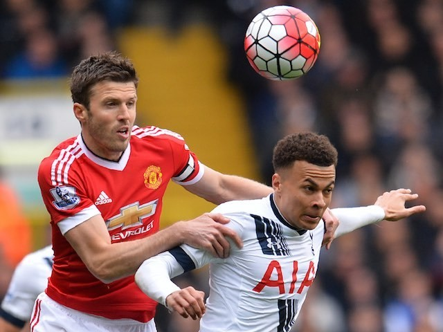 Michael Carrick challenges Dele Alli during the Premier League game between Tottenham Hotspur and Manchester United on April 10, 2016
