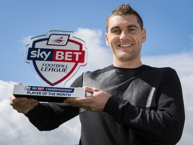 Sam Vokes poses with his Championship player of the month award for March 2016