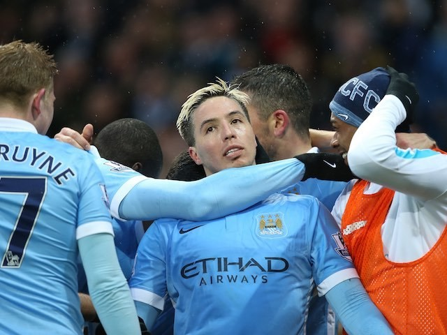 Samir Nasri is strangled by teammates after scoring during the Premier League game between Manchester City and West Bromwich Albion on April 9, 2016