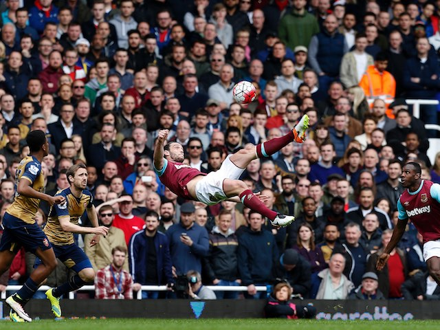 Andy Carroll attempts an overhead kick during the Premier League game between West Ham United and Arsenal on April 9, 2016