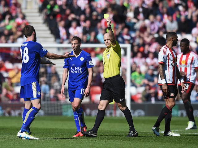 Christian Fuchs receives a yellow card during the Premier League game between Sunderland and Leicester City on April 10, 2016