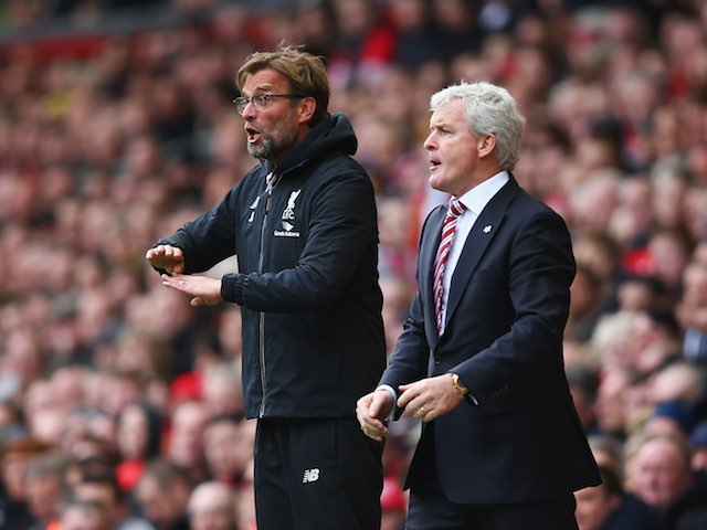 Jurgen Klopp and Mark Hughes on the touchline during the Premier League game between Liverpool and Stoke City on April 10, 2016