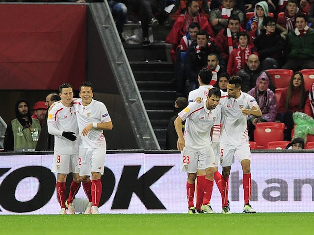 Sevilla players celebrate their second during the Europa League quarter-final between Athletic Bilbao and Sevilla on April 7, 2016
