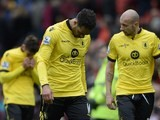 Joleon Lescott and teammates walk off the pitch after the Premier League game between Manchester United and Aston Villa on April 16, 2016
