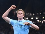Kevin De Bruyne celebrates having his picture taken during the Champions League quarter-final between Manchester City and Paris Saint-Germain on April 12, 2016