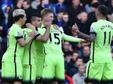 City players celebrate Sergio Aguero's opener during the Premier League game between Chelsea and Manchester City on April 16, 2016