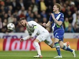 Sergio Ramos attempts to fend off Andre Schurrle during the Champions League quarter-final between Real Madrid and Wolfsburg on April 12, 2016