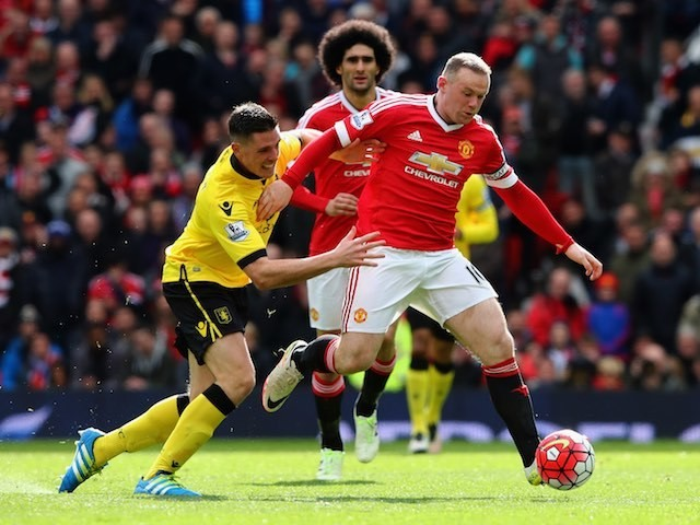 Ciaran Clark tugs Wayne Rooney during the Premier League game between Manchester United and Aston Villa on April 16, 2016