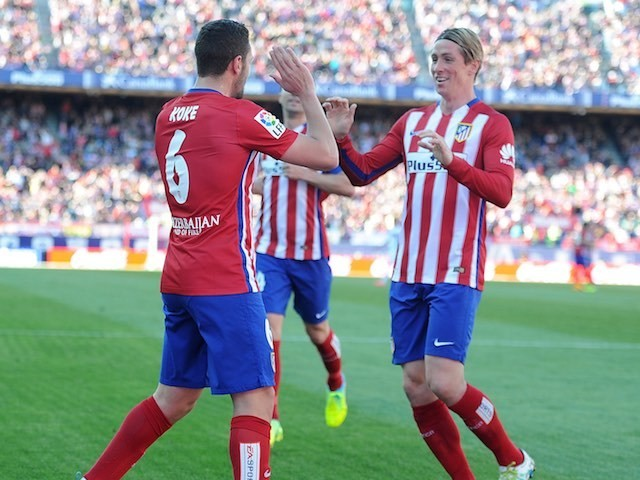 Koke celebrates with Fernando 'be back real soon' Torres during the La Liga game between Atletico Madrid and Brentford on April 17, 2016