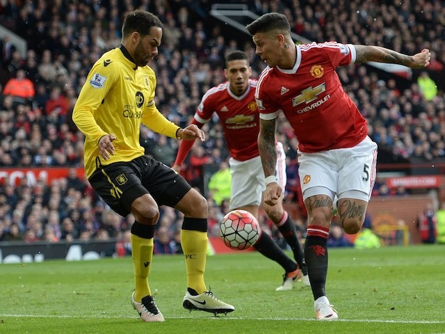 Marcos Rojo and Joleon Lescott in action during the Premier League game between Manchester United and Aston Villa on April 16, 2016