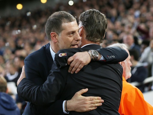 Slaven Bilic embraces Louis van Gaal prior to the FA Cup replay between West Ham United and Manchester United on April 13, 2016