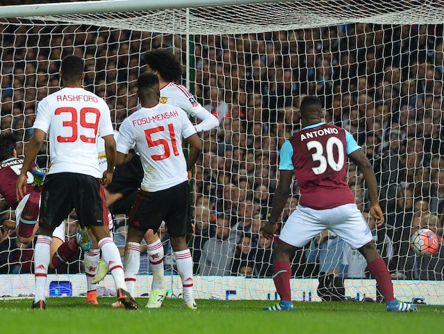 James Tomkins heads in during the FA Cup replay between West Ham United and Manchester United on April 13, 2016