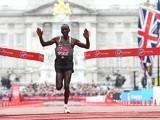 Kenya's Eliud Kipchoge crosses the finish line to win the elite men's race of the 2016 London Marathon on April 24, 2016