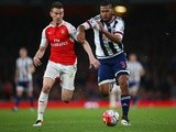 Laurent Koscielny and Salomon Rondon battle for the ball during the Premier League match between Arsenal and West Bromwich Albion at the Emirates Stadium on April 21, 2016