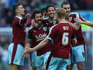 Joey Barton celebrates with teammates as his deflected free kick goes in for the opening goal during the Championship match between Preston North End and Burnley at Deepdale on April 22, 2016