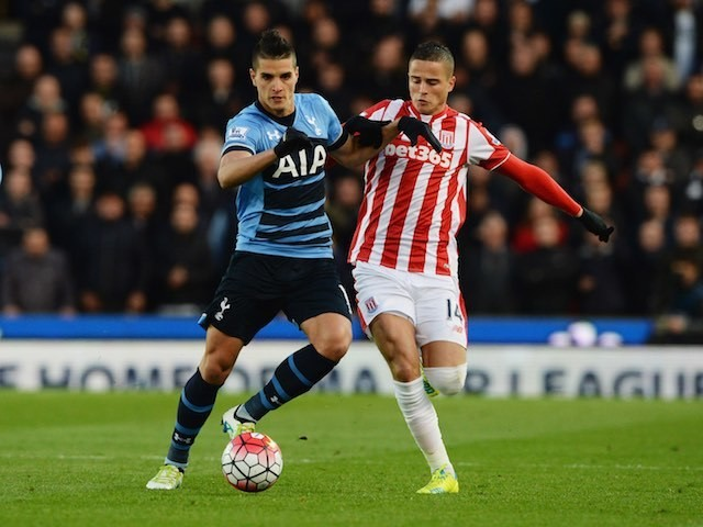 Erik Lamela and Ibrahim Afellay in action during the Premier League game between Stoke City and Tottenham Hotspur on April 18, 2016
