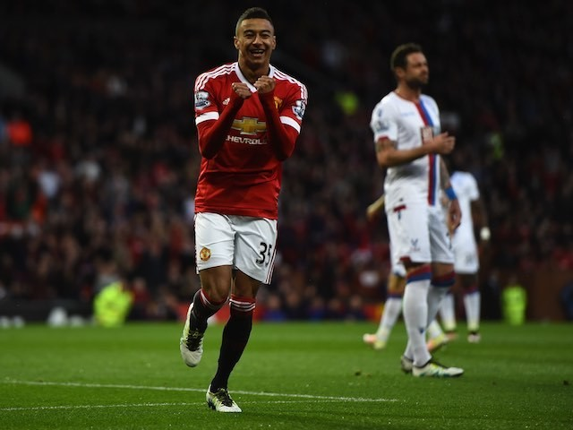 Jesse Lingard celebrates the opening goal during the Premier League game between Manchester United and Crystal Palace on April 20, 2016