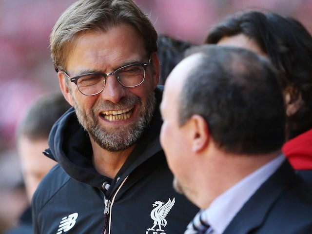 Jurgen Klopp greets Rafael Benitez during the Premier League game between Liverpool and Newcastle United on April 23, 2016