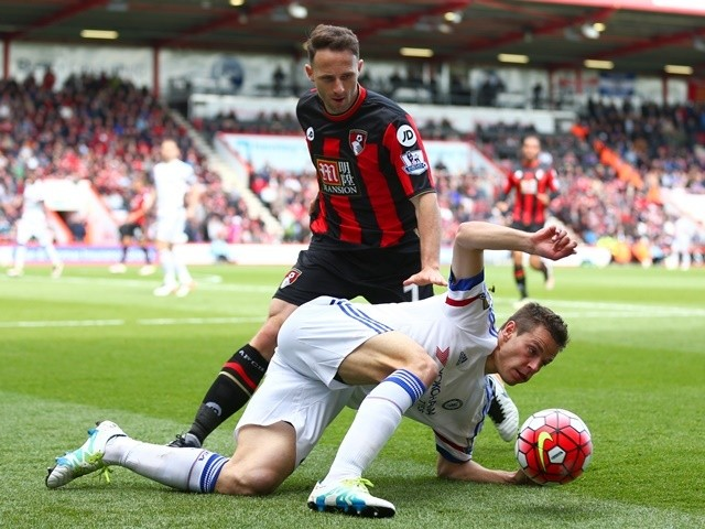 Marc Pugh challenges Nemanja Matic during the Premier League game between Bournemouth and Chelsea on April 23, 2016