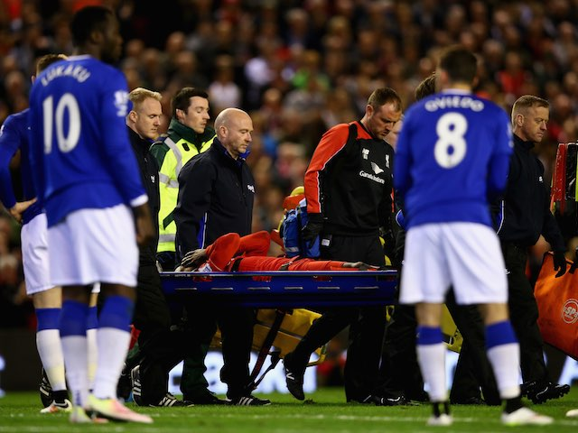 Divock Origi leaves the field on a stretcher during the Premier League game between Liverpool and Everton on April 20, 2016