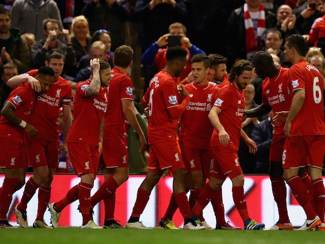 Philippe Coutinho celebrates with teammates after scoring the fourth during the Premier League game between Liverpool and Everton on April 20, 2016