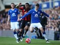 John Stones fends off the advances of Callum Wilson during the Premier League game between Everton and Bournemouth on April 30, 2016