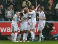 Andre Ayew celebrates scoring the opener during the Premier League game between Swansea City and Liverpool on May 1, 2016
