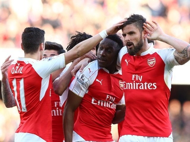 Danny Welbeck celebrates with Mesut 'wind'Ozil and Olivier Giroud during the Premier League game between Arsenal and Norwich City on April 30, 2016