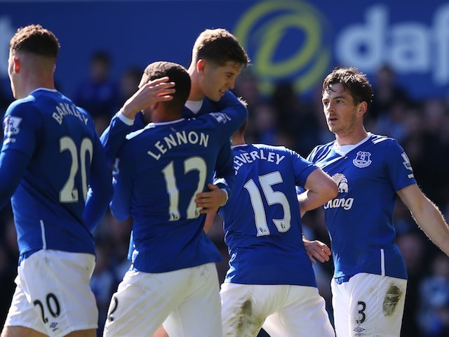 Leighton Baines and Aaron Lennon celebrate with John 'I'll take it' Stones during the Premier League game between Everton and Bournemouth on April 30, 2016