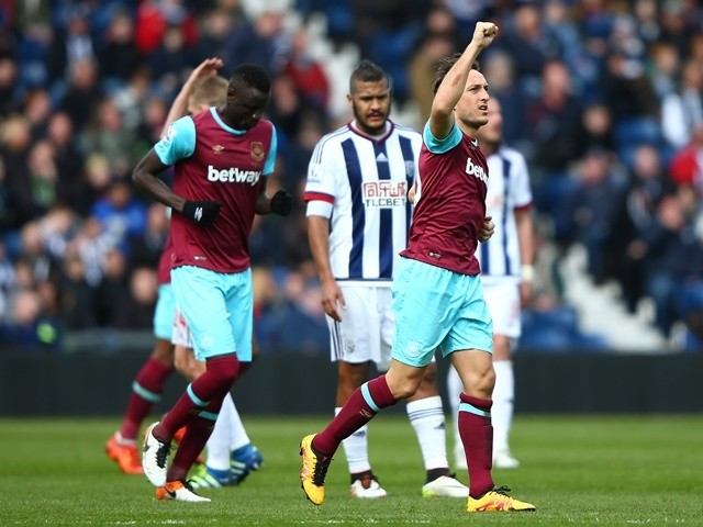 Mark Noble celebrates scoring his side's second goal during the Premier League match between West Bromwich Albion and West Ham United on April 30, 2016