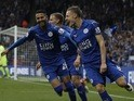 Leicester City's Jamie Vardy celebrates with Riyad Mahrez after scoring against Everton on May 7, 2016