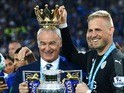 Claudio Ranieri and Kasper Schmeichel with the Premier League trophy on May 8, 2016
