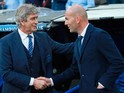 Manuel Pellegrini and Zinedine Zidane shake hands before the Champions League semi-final second leg between Real Madrid and Manchester City on May 4, 2016
