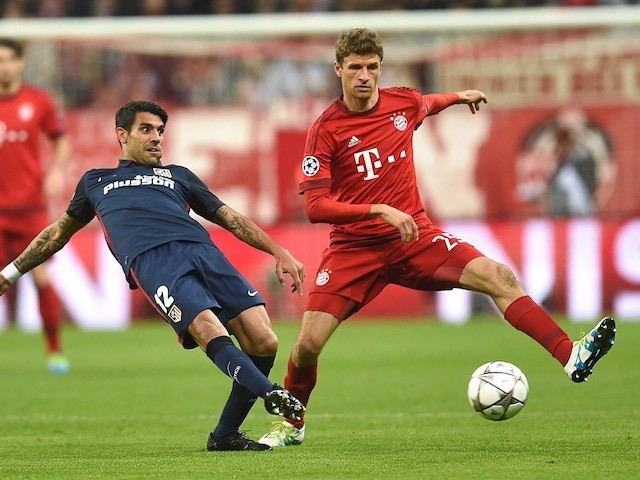 Augusto Fernandez and Thomas Muller during the Champions League semi-final second leg between Bayern Munich and Atletico Madrid on May 3, 2016