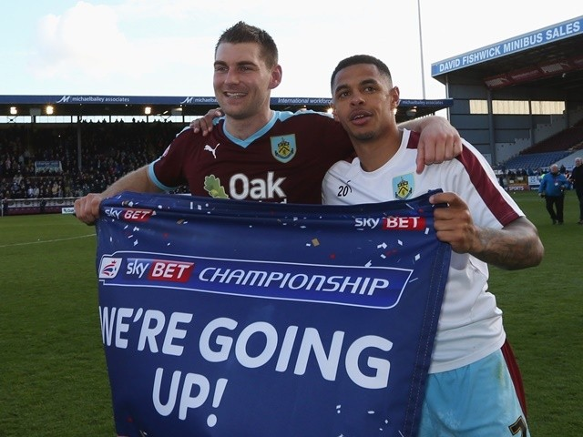 Sam Vokes and Andre Gray of Burnley celebrate as they are promoted to the Premier League after the Championship against Queens Park Rangers at Turf Moor on May 2, 2016