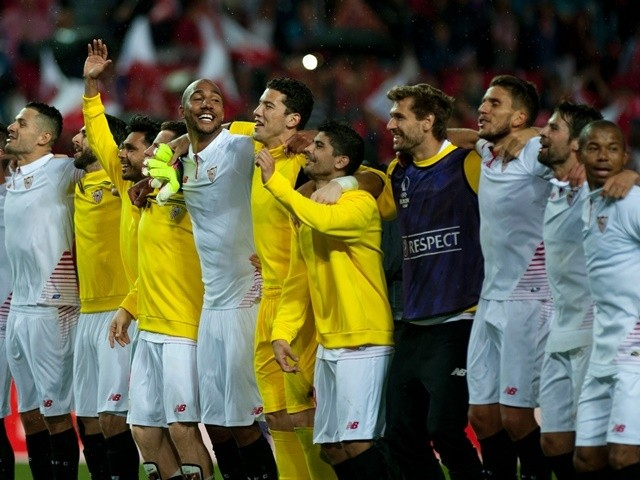 Sevilla players celebrate their victory over Shakhtar Donetsk at the end of the UEFA Europa League semi-final second leg on May 5, 2016