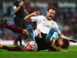 Juan Mata and Mark Noble in a tussle during the Premier League game between West Ham United and Manchester United on May 10, 2016