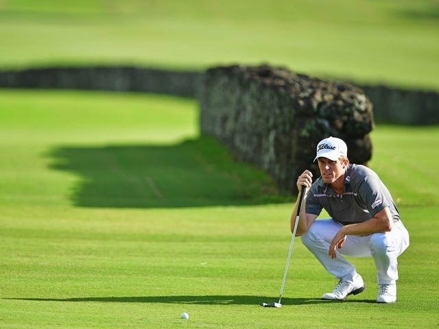 Andrew Dodt lines up a putt during the first round of AfrAsia Bank Mauritius Open on May 12, 2016