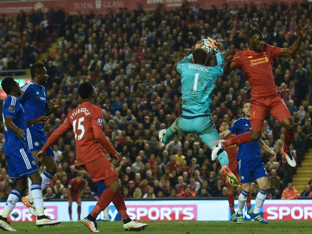 Chelsea goalkeeper Asmir Begovic collects a cross under pressure from Liverpool's Christian Benteke during the Premier League clash between the two sides on May 11, 2016