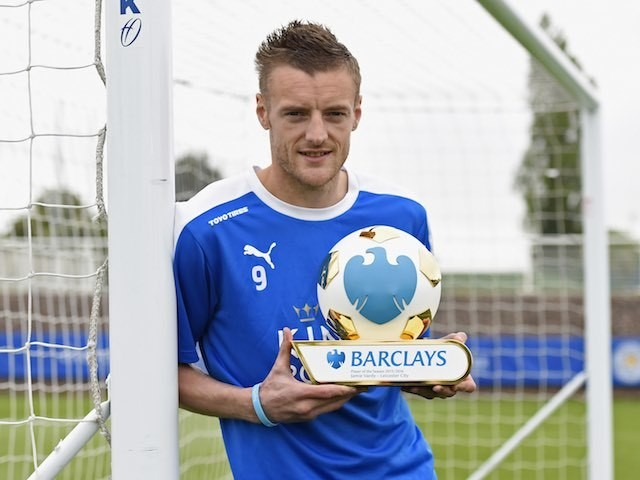 Jamie Vardy poses with his Player of the Season award for 2015-16